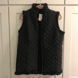 Reversible black quilted vest